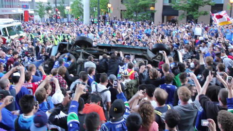 Rioting crowd overturn a pickup truck Footage