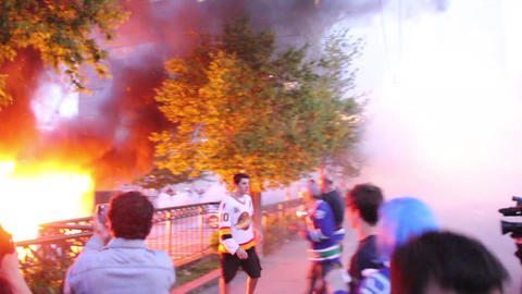 2 cop cars burn while riot officers throw tear gas Footage