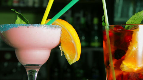 Dolly Shot Of Four Refreshing Cocktails On The Bar stock footage