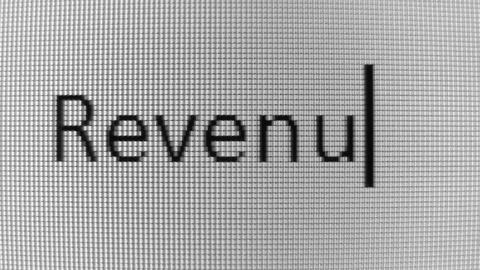 Typing High tech and Revenue words on BW PC screen Stock Video Footage