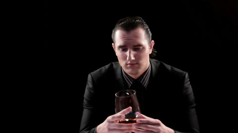 businessman drinking wine on black background Stock Video Footage
