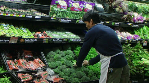 Man Facing Broccoli In Produce Footage