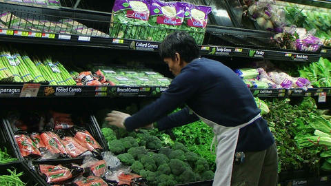 Man Facing Broccoli In Produce Stock Video Footage