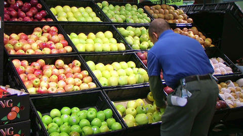 Man Facing Apples In Produce 03 Stock Video Footage