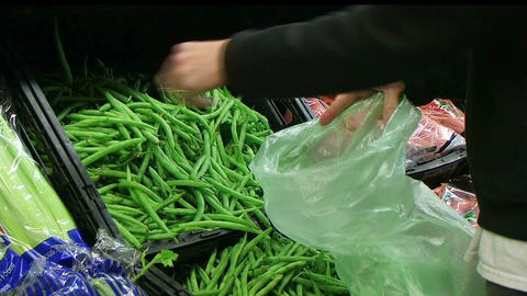 Woman Selecting Green Beans In Produce Stock Video Footage