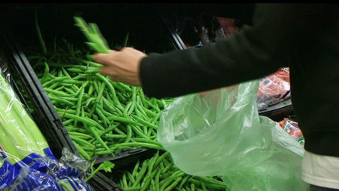 Woman Selecting Green Beans In Produce Footage
