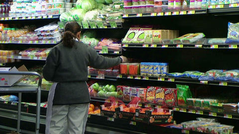 Woman Stocking Tomatoes In Produce Stock Video Footage