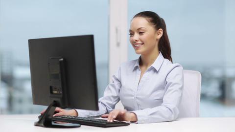 businesswoman with computer in office Footage