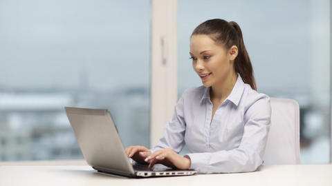 smiling businesswoman or student with laptop Footage