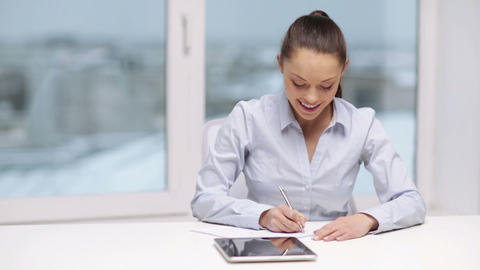 smiling businesswoman with tablet pc in office Footage