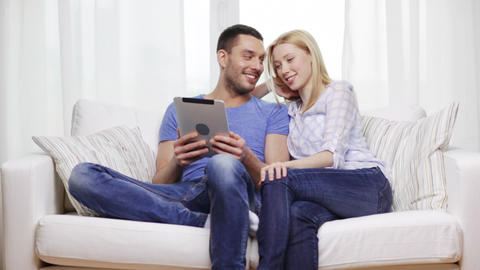 smiling happy couple with tablet pc at home Footage