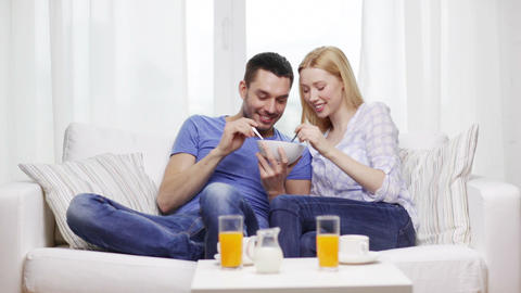 smiling couple having breakfast at home Footage