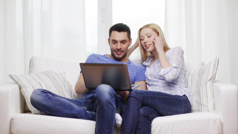 smiling couple with laptop computer at home Footage