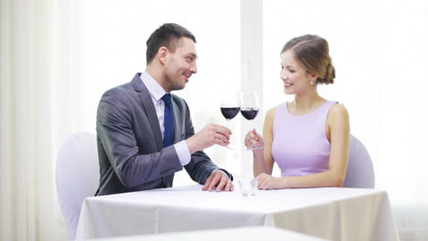 young couple with glasses of wine at restaurant Footage