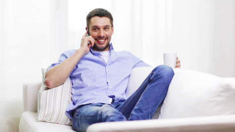 laughing man with smartphone at home Footage