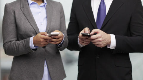 Businessman And Businesswoman With Smartphones stock footage