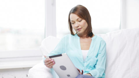 calm woman with tablet pc computer at home Footage