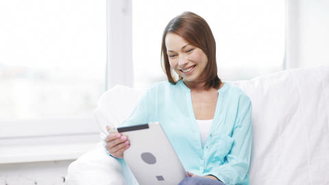 smiling woman with tablet pc computer at home Footage
