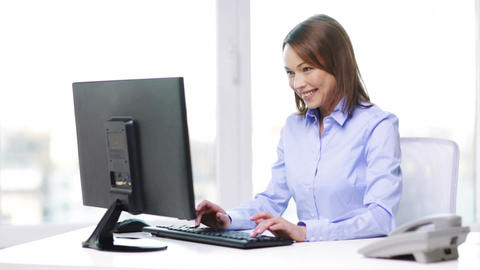 businesswoman with telephone and computer Footage