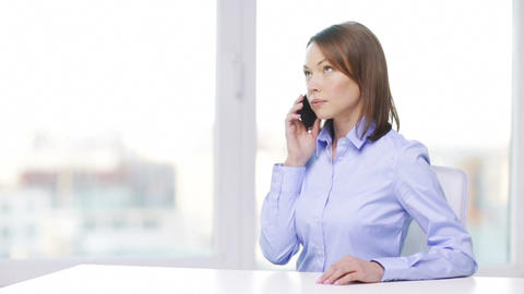 busy businesswoman with smartphone in office Footage