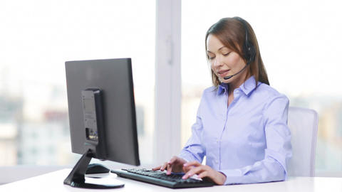 female helpline operator with computer at office Footage