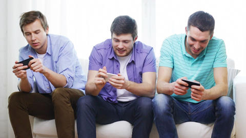 smiling friends with smartphones at home Footage