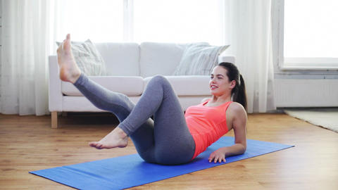 Smiling Teenage Girl Doing Exercise For Legs stock footage