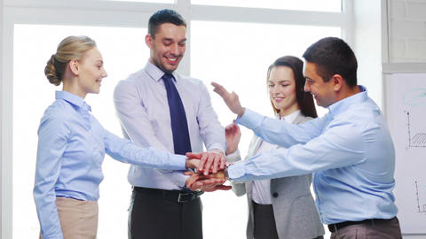 team with hands on top of each other in office Footage