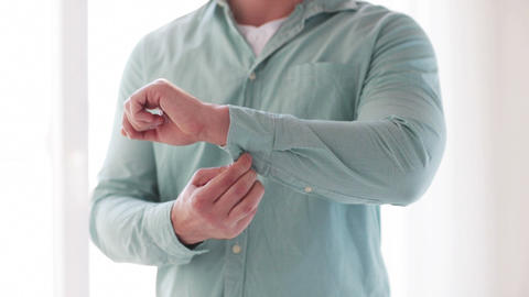 Man Unbuttoning His Sleeve At Home stock footage