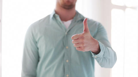 closeup of man showing thumbs up Footage
