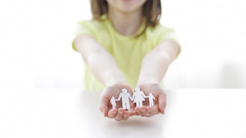 Smiling Little Girl Showing Paper Man Family stock footage