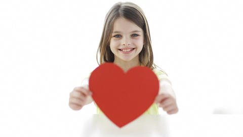 smiling girl with red heart at home Footage