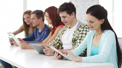 smiling students with tablet pc at school Footage