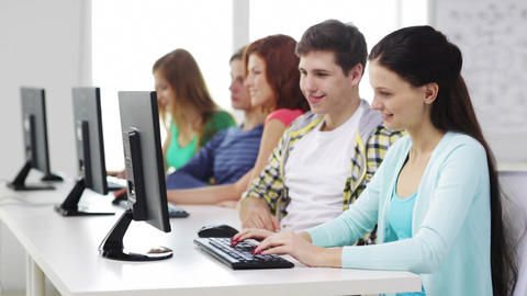 smiling students working with computers at school Footage