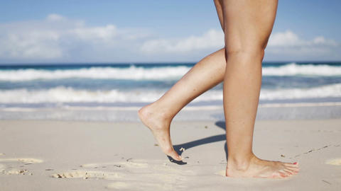 Close Up Of Woman Legs Walking On Beach stock footage