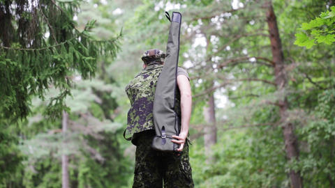 young soldier or hunter with gun in forest Footage