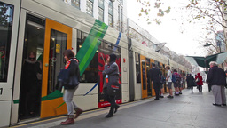 Commuters in a busy tram station in Melbourne Footage