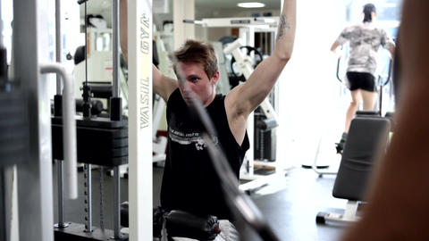 Young Man Uses Lat Machine (training apparatus) Footage