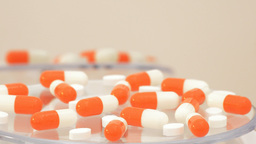 Orange capsule rotating. Loop. Medication ビデオ