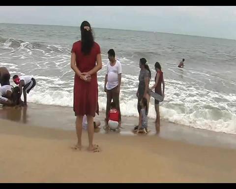 A Family Enjoying At Mahabalipuram Beach stock footage