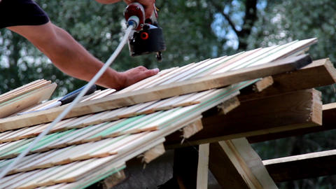 Using a machine to nail in the cedar wooden shingl Footage