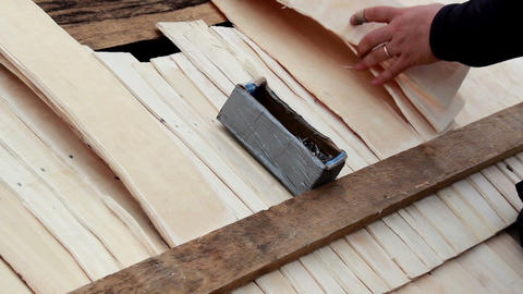 Box of nails on top of the cedar wooden shingle sh Footage
