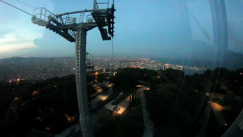 Cable car approaching a big pole in Spain night Ba Footage