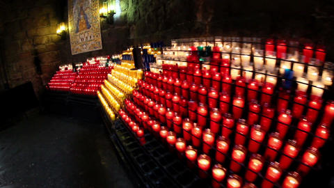 Several lighted candles on the church Footage