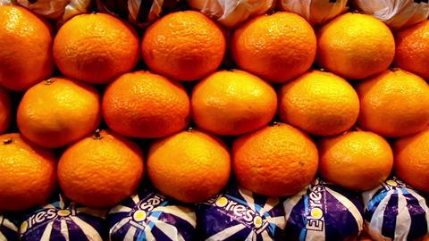 Orange neatly piled lots of oranges on display Footage