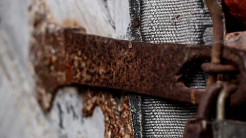 Up close of the rusty padlock Footage