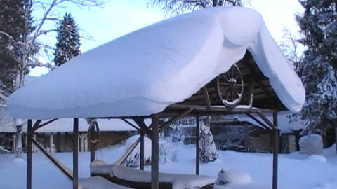 Roof of the shed is covered in a lot of snow Footage