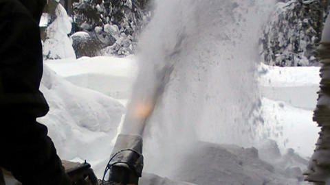 Removing snow using a snowblower machine Footage