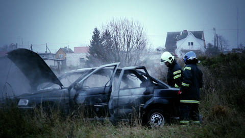 Firemen checking the car with smoke Footage