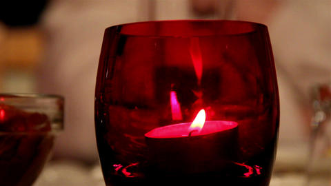 A candlelight inside a red glass Live Action